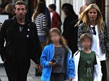 Health-conscious Gwyneth Paltrow and Chris Martin treat their kids to food truck fare during rare public family outing in Venice Beach