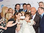 Joan Collins takes famous selfie at the Prince's Trust event