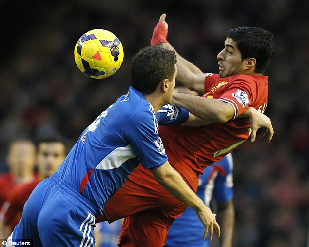Battle: Suarez and Bruce go head to head again as the pair wrestle for possession of the ball