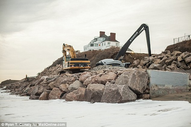 Protection: The diggers are working to rip up the coastline around the exclusive and historic Water Hill mansion in Rhode Island