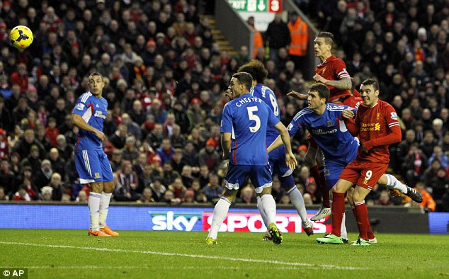 Head start: Daniel Agger rose to nod home Liverpool's opening goal of the game
