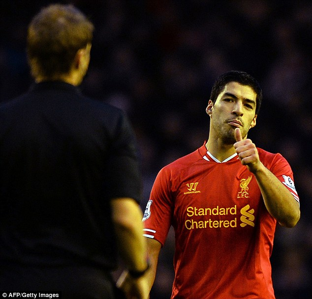 Nice one: Suarez gives Pawson a thumbs-up during the second half