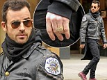 Justin Theroux rocks gaudy gold nameplate bauble on his left-ring finger for solo NYC stroll