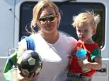 She's got the single parent juggling act down! Hilary Duff expertly totes son Luca, a bulging bag of goodies and a soccer ball on outing to the park