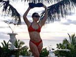 Killer curves: Mariah Carey shows off her curvy figure in a bright red bikini via her Instagram account on Wednesday