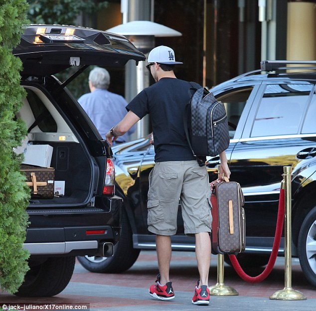 Countdown begins: Ryan Sweeting checked into the posh Four Seasons Hotel in Beverly Hotel on Tuesday just hours before his New Year's Eve wedding to Kaley Cuoco