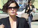 Teri Hatcher cuts a sophisticated figure in black blazer and slim fitting jeans as she leaves the gym
