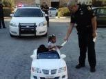 Za'Dariyah Mishaw, 2, receiving her first ever speeding ticket from Jacksonville Sherrif's office
