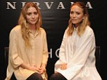 Nothing to see here! Mary-Kate Olsen hides huge engagement ring in a billowing smock while launching new fragrances with Ashley