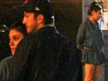 Mila Kunis hides her stomach with billowing shirt dress as she and Ashton Kutcher enjoy dinner date with his co-star Jon Cryer