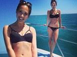 Myleene Klass poses in black cut-out bikini