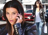 No time to waste! Kim Kardashian heads straight to beauty salon still in her skinny jeans and leather jacket after landing at LAX