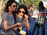 Sister act: Kendall and Kylie Jenner enjoy a meal together in California