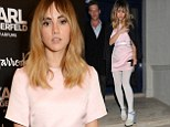Not all-white on the night: Suki Waterhouse suffers a fashion fail in pale-coloured tights with open-toe stilettos