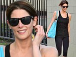 Someone's having a good day! Ashley Greene is bursting with smiles as she stops to sign autographs in full workout getup