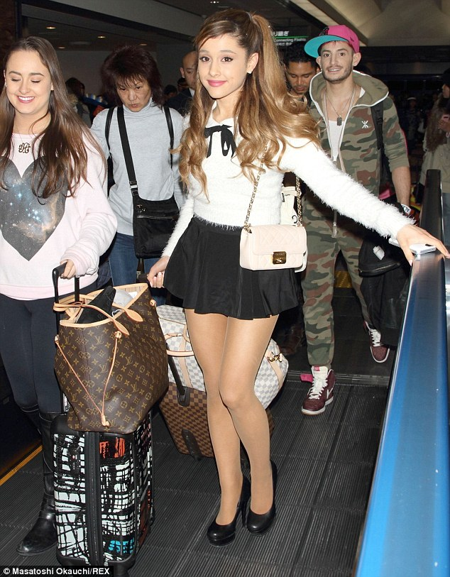 Konichiwa! Ariana Grande wore a daringly short miniskirt and fluffy jumper as she arrived in Japan on Tuesday