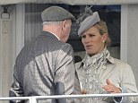 Zara enjoys a glass of champagne as she chats to a fellow racing enthusiast inside the temporary Royal box at Cheltenham