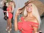 She's brimming over: Courtney Stodden tips her hat as she dines out wearing skin-tight cleavage-bearing coral dress