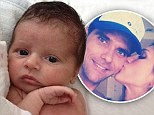 'Our little boy!' Mark Philippoussis's wife Silvana Lovin releases first picture of couple's baby boy and revels they have named him Nicholas Emanuel