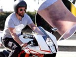 That looks painful! Bradley Cooper displays nasty looking bruise on his arm during motorcycle ride