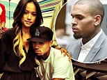 Stand by your man! Karrueche Tran 'defends Chris Brown in assault lawsuit where woman claims he shoved her in a nightclub'