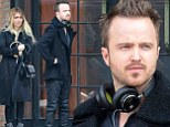 It shouldn't work but it does! Aaron Paul and Lauren Parsekian wear matching leather trousers for a cold day in New York