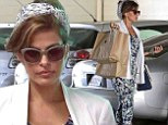 In bloom! Eva Mendes hauls shopping bags in floral jumpsuit and sky-high pumps