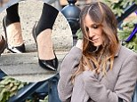 She's REALLY trying to make them happen! Sarah Jessica Parker steps out again in stirrup leggings as she teams them with navy floral dress