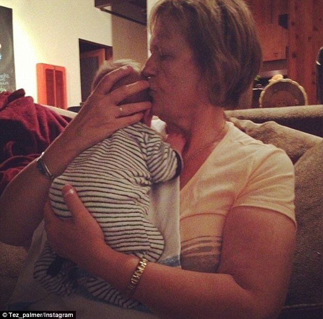 Nan's touch: The stunning blonde shared a photo of her new bundle of joy in her mother's arms, gushing about how grateful she is for her mother's love and support
