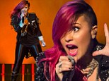 She's red hot! Demi Lovato is on fire as she rocks new punk hairstyle on stage in Michigan