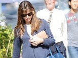 Old faithful: Jennifer carried her oversized blue tote with zipper detail with her in LA