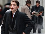 Hot off the press: Robert Pattinson was pictured rushing around the Life movie set in his role as photographer Dennis Stock