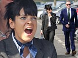 Boyish: Instead instead of opting for a dress and hat, Lily Allen turned heads in a suit as she attended Cheltenham Festival with her husband