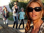 Riders of the storm! Denise Richards distracts daughters from the drama with their father Charlie Sheen by taking them horse riding