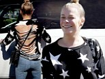 Revealing: LeAnn Rimes wore a star-spangled slashed top as she shopped at The Commons in Calabasas