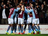 Elation: Delph (obscured) is congratulated by team-mates after scoring