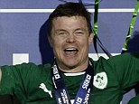 Jubilation: O'Driscoll clasps hold of the 6 Nations trophy after the presentation in Paris