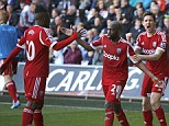 Pure joy: West Brom players celebrate Mulumbu's (centre) decisive striker at the Liberty Stadium on Saturday