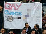 Controversial: Bayern Munich fans display a homophobic banner before kick-off against Arsenal