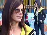 Sandra Bullock goes make-up free and reveals trim physique in neon accented jacket and spandex leggings