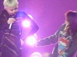 'What the f*** is that?' Miley Cyrus goes on foul-mouthed rant after fan gets in trouble for taking photo at her concert... then pulls her onstage
