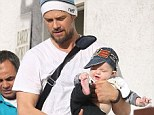 Hat's my boy: Axl rocked a mini cap, dressed to match his father
