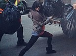 She likes trash! Alec Baldwin's wife Hilaria Baldwin pulls off yoga pose while helping garbage men clean up NYC