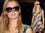 Paris Hilton makes a triumphant return to Los Angeles in colourful dress after promotional tour in Philippines