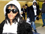 Just hold on, I'm going home: Rihanna jets back to New York in boyfriend jeans and a hoodie leaving beau Drake in UK
