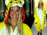 Purrrfect! Bar Refaeli celebrates Purim by masquerading in a bright yellow tiger suit... which she teams with a Chanel handbag