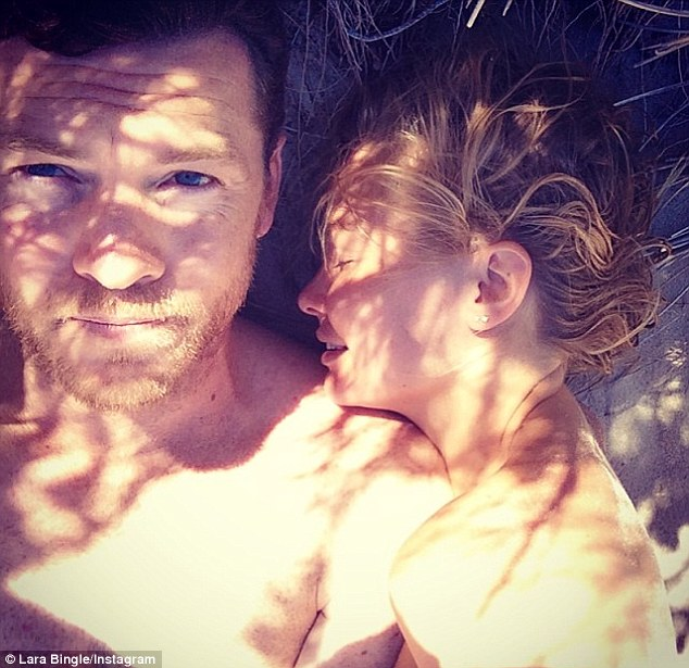 Basking in the sunshine: Lara shared a picture of herself and Sam relaxing on the beach in Sydney last week