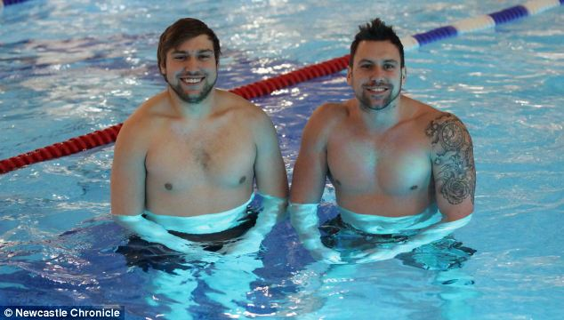 Mr Aitken (right, with his brother, Ross) has made a full recovery and returned to work as a swimming teacher