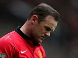 Head down: Rooney appears dejected after Liverpool took a one-goal lead