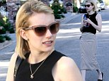 Emma Roberts is a pretty woman in pencil skirt